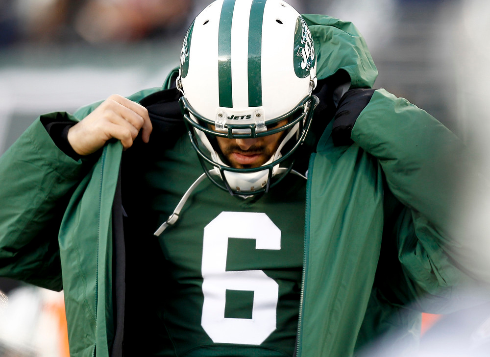 . Mark Sanchez #6 of the New York Jets puts on a coat during a game against the San Diego Chargers at MetLife Stadium on December 23, 2012 in East Rutherford, New Jersey. (Photo by Jeff Zelevansky /Getty Images)