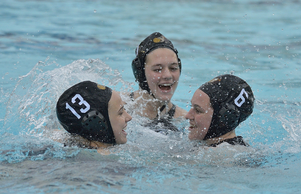 . LONG BEACH, CALIF. USA -- Wilson\'s Jessica King (13), Devon Beebe (11) and Alana Gans (6) celebrate their win over Poly in Long Beach, Calif., on February 7, 2013. Wilson defeated Poly, 6 to 5, to win the Moore League. Photo by Jeff Gritchen / Los Angeles Newspaper Group