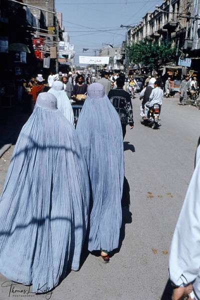 Women in Burkha go about their daily shopping.Traditional norms forbid women to be expose their faces in public. Peshawar.