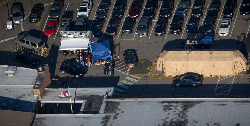 ". Police and other officials stand outside Sandy Hook Elementary School in this aerial photograph a day after a mass shooting at the school in Newtown, Connecticut December 15, 2012. Investigators assembled ""some very good evidence\"" to explain what drove a 20-year-old gunman to slaughter 20 children and six adults at an elementary school, police said on Saturday, a day after one of the worst mass shootings in U.S. history shattered a small Connecticut town. REUTERS/Adrees Latif"