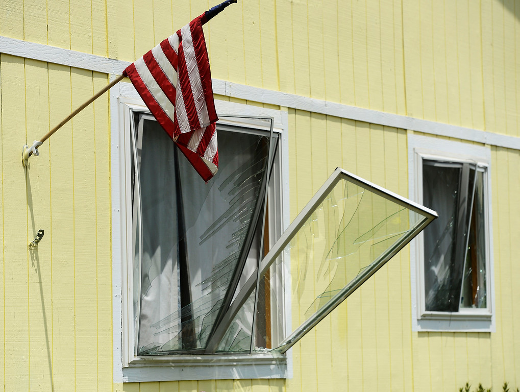 . Blown out windows on a house across the street from a house that exploded on the 9300 block of Ingalls Street in Westminster, Colorado, Thursday afternoon June 13, 2013.  (Photo By Andy Cross/The Denver Post)