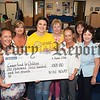 Sorcha MacLaimhin from the Cancer Fund for Children accepts a cheque for £1305 from Elaine Rafferty, Diane McCabe, Asumpta Hyland, Eileen Grant, Francine Curran and Doreen Curren. The money was raised through a Coffee Morning on the 11th May. R1623004