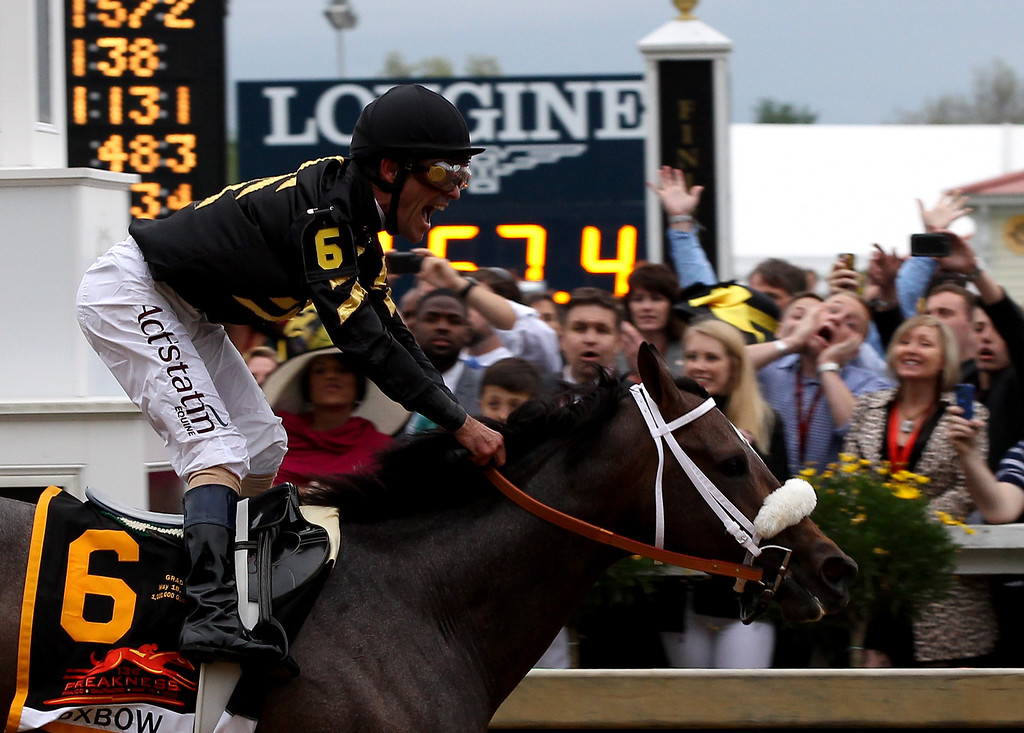 . BALTIMORE, MD - MAY 18:  Gary Stevens celebrates atop of Oxbow #6 as he crosses the finish line to win the 138th running of the Preakness Stakes at Pimlico Race Course on May 18, 2013 in Baltimore, Maryland.  (Photo by Justin Heiman/Getty Images)