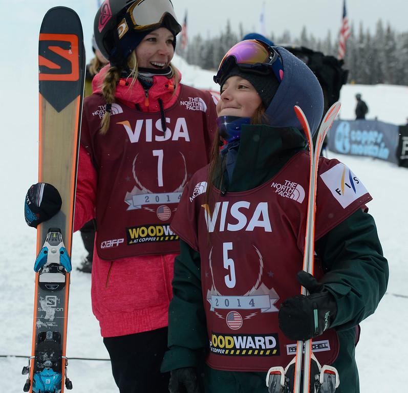 . Skier, Darian Stevens, right, reacts to placing second at the U.S. Grand Prix slope style finals at the Copper Mountain ski area Saturday afternoon, December 21, 2013. Competitor, Dara Howell, left, won.  (Photo By Andy Cross / The Denver Post)