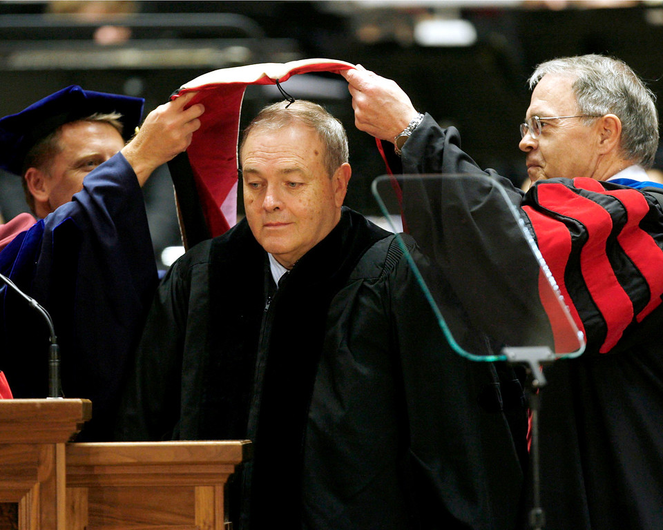 . Dean Singleton, center, Vice-Chairman, CEO and founder of MediaNews Group, the nation\'s second largest newspaper company, receives an honorary degree from University of Utah as trustees Taylor Randall, left, and Jim Wall place a hood over his head in recognition of his honorary doctorate of business during commencement ceremonies at the Jon M. Huntsman Center in Salt Lake City on Friday, May 7, 2010. Francisco Kjolseth / The Salt Lake Tribune