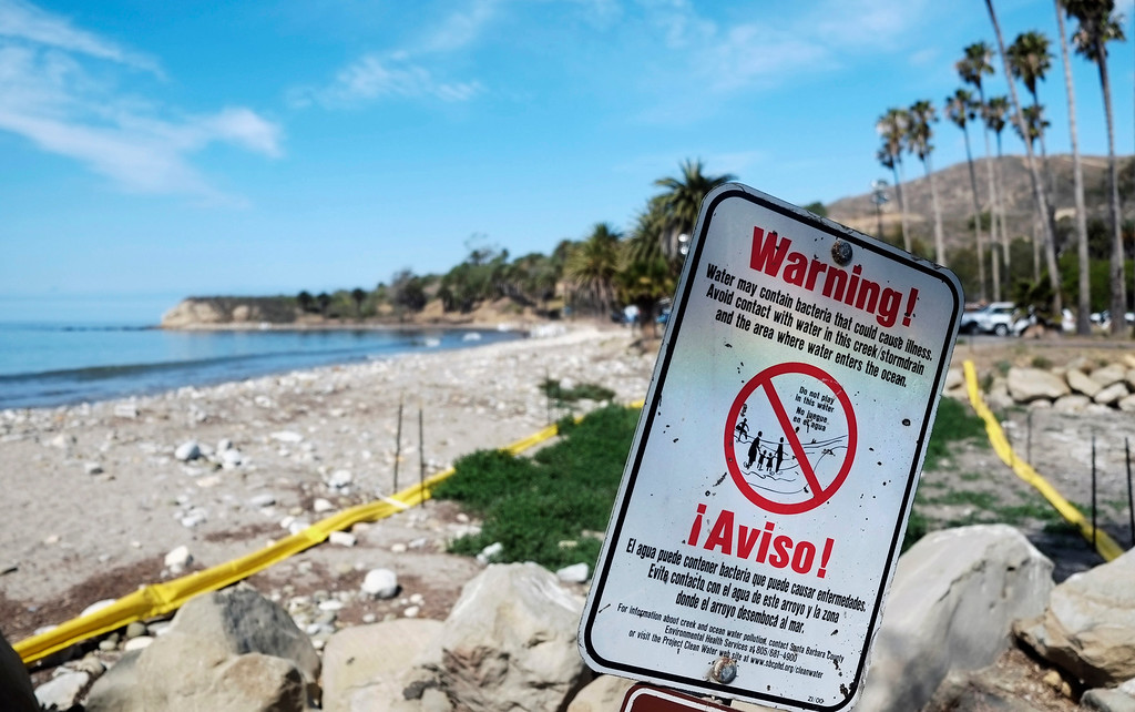 . Yellow containment booms block oil from a culvert at Refugio State Beach, north of Goleta, Calif., Wednesday, May 20, 2015.  A broken onshore pipeline spewed oil down a storm drain and into the ocean for several hours Tuesday before it was shut off, creating a slick some 4 miles long about 20 miles west of Santa Barbara.  (AP Photo/Michael A. Mariant)