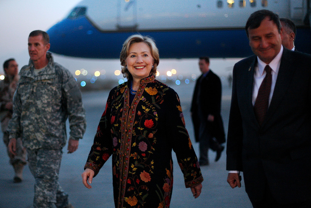 . U.S. Secretary of State Hillary Rodham Clinton, center, is welcomed by top U.S. commander Gen. Stanley McChystal, left, and U.S. Ambassador Karl Eikenberry at the military airport in Kabul, Afghanistan, Wednesday, Nov. 18, 2009.   (AP Photo/Anja Niedringhaus)