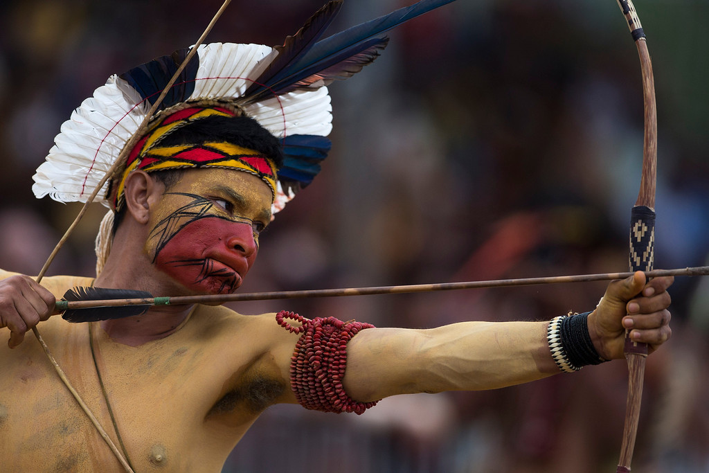 . A Pataxo Indian takes part in the bow and arrow competition during the indigenous games in Cuiaba, Brazil, Tuesday, Nov. 12, 2013. Around 1,600 Indians from 48 tribes are celebrating Brazil\'s indigenous cultures during the 12th edition of the Games of the Indigenous People, which runs until Nov. 16. (AP Photo/Felipe Dana)