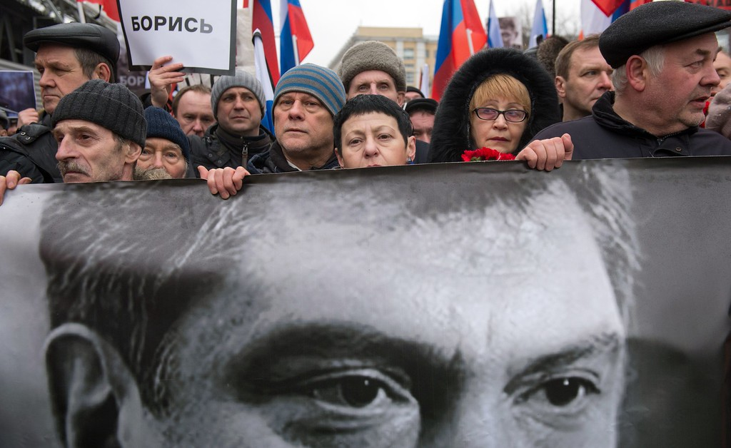 . Russia\'s opposition supporters carry a banner bearing a portrait of Kremlin critic Boris Nemtsov during a march in central Moscow on March 1, 2015. The 55-year-old former first deputy prime minister under Boris Yeltsin was shot in the back several times just before midnight on February 27 as he walked across a bridge a stone\'s throw from the Kremlin walls. ALEXANDER UTKIN/AFP/Getty Images