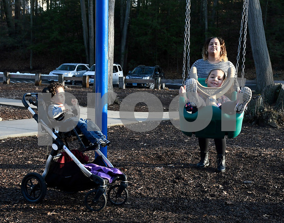 2/20/2018 Mike Orazzi | Staff Crystal Rivera with her children Jaden,3, and Julianna,4, while enjoying an unusually warm day in February Tuesday.