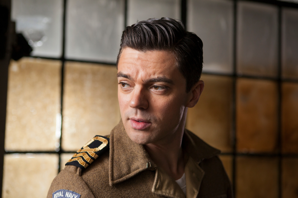 . Dominic Cooper as Ian Fleming in the Interrogation room corridor. (Photo by Egon Endrényi)