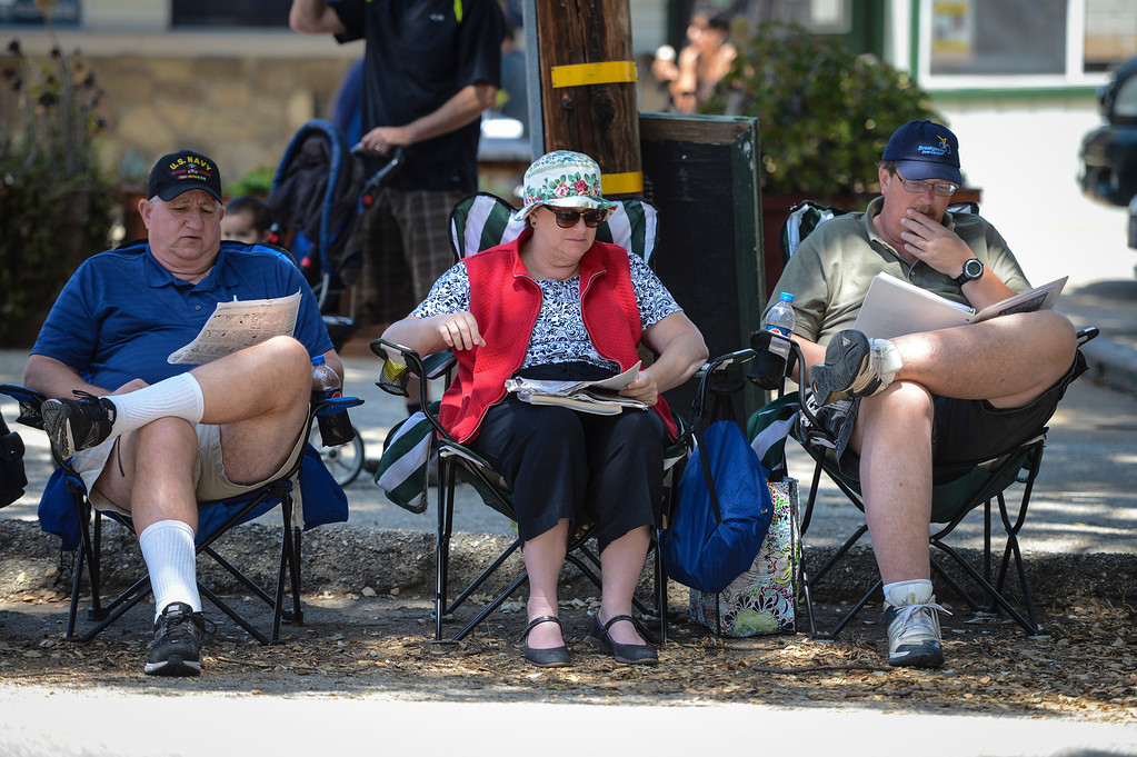 . Cycling fans Jack Sanders, Ann Nelson and Bruce Nelson wait for stage 4 of the Amgen Tour of California along highway 150 Wednesday.  Stage 4 of the Amgen Tour of California started in Santa Clarita and ended in Santa Barbara.  Photo by David Crane/Staff Photographer