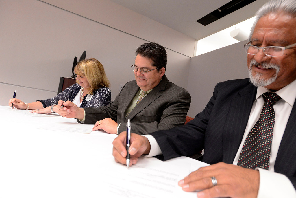 . From left to right:  Supervisor Janice Rutherford, Los Angeles Newspaper Group Vice President Michael Anastasi, and Dean Cesar Caballero sign over the transferal of The Sun\'s archives to the County at California State University San Bernardino April 8, 2013.   GABRIEL LUIS ACOSTA/STAFF PHOTOGRAPHER.