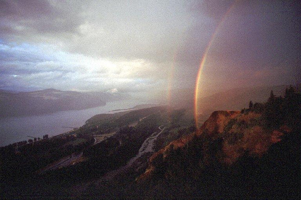 From Crown Point a rainbow can be seen when viewing east up the Columbia River with WA on the left and OR on the right.