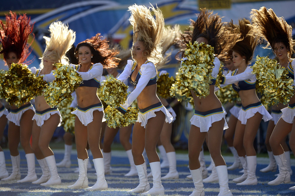 . The San Diego Chargers Cheerleaders perform in between quarters during the game against # of the Cincinnati Bengals on December 1, 2013 at Qualcomm Stadium in San Diego, California. (Photo by Donald Miralle/Getty Images)