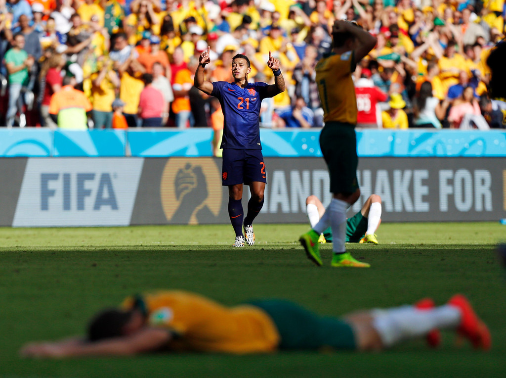 . Netherlands\' Memphis Depay celebrates his team\'s 3-2 victory over Australia during the group B World Cup soccer match between Australia and the Netherlands at the Estadio Beira-Rio in Porto Alegre, Brazil, Wednesday, June 18, 2014.  (AP Photo/Jon Super)