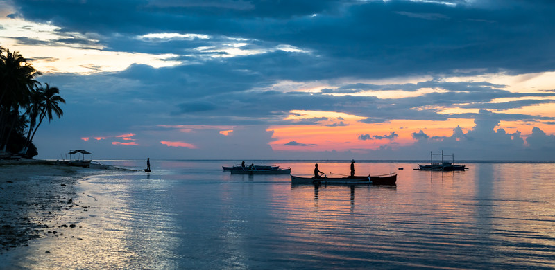 Local fishermen head out for the morning catch at Anda on the island of Bohol in the Philippines