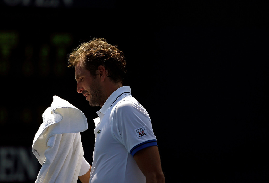 . Julien Benneteau, of France, wipes sweat from his face during a first round match against Michal Przysiezny, of Poland, in the 2013 U.S. Open tennis tournament Tuesday, Aug. 27, 2013, in New York. (AP Photo/David Goldman)