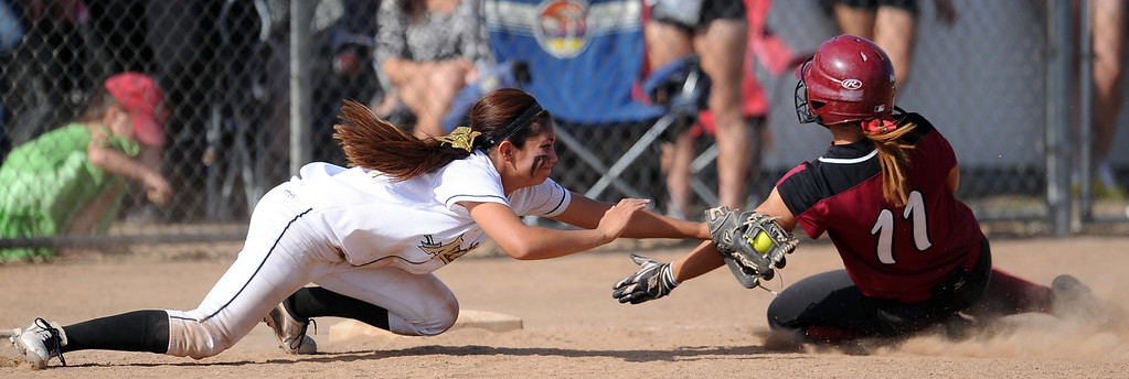 . Northview\'s Haley Gomez tags out Barstow\'s Miranda Peralta (11) at third base in the seventh inning of a CIF-SS quarterfinal playoff softball game at Northview High School on Thursday, May 23, 2013 in Covina, Calif. Northview won 5-4.  (Keith Birmingham Pasadena Star-News)