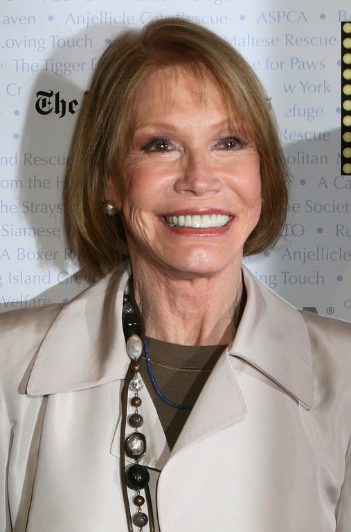 ". Mary Tyler Moore poses for a photograph at Broadway Barks 9!, Saturday July 14, 2007 in New York.  The dog and cat adopt-a-thon assists New York animal shelters in their mission to find  ""homeless\"" animals good homes.  (AP Photo/Tina Fineberg)"