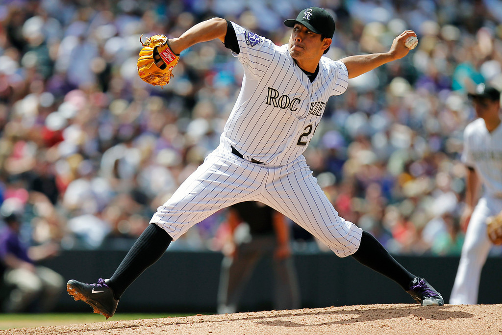 . Colorado Rockies starting pitcher Jorge De La Rosa (29) throws against the Arizona Diamondbacks during the fifth inning of a baseball game Wednesday, May 22, 2013 in Denver. The Rockies won 4-1. (AP Photo/Barry Gutierrez)