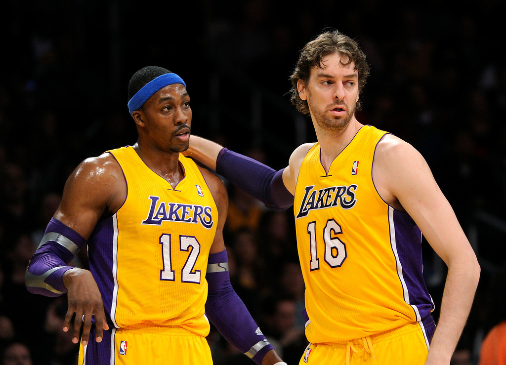 . The Lakers\' Dwight Howard, left, and Pau Gasol congratulate each other after a foul on the Jazz in the first half, Friday, January 25, 2013, at Staples Center. (Michael Owen Baker/L.A. Daily News)