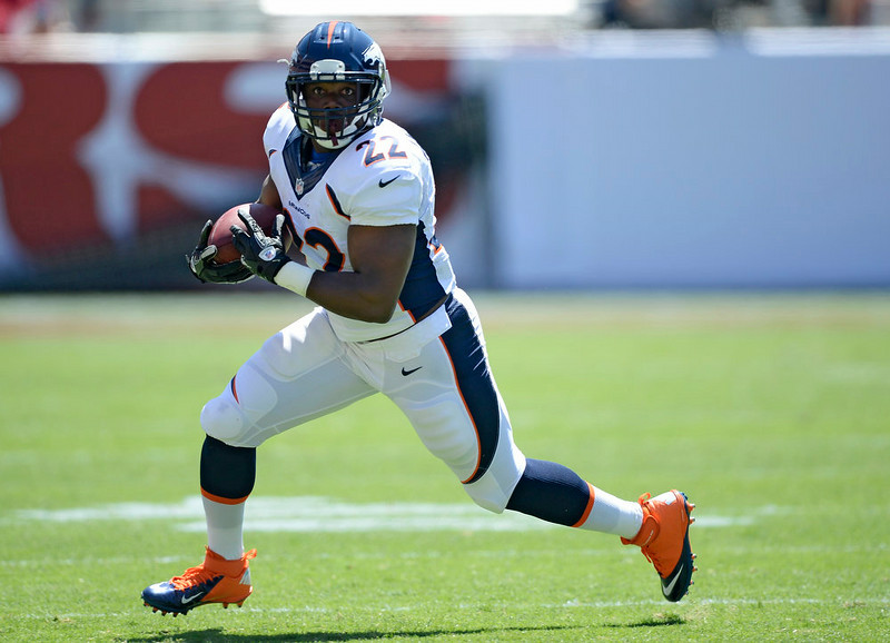 . Denver Broncos running back C.J. Anderson (22) picks up a few yards during the second quarter against the  San Francisco 49ers August 17, 2014 at Levi\'s Stadium. (Photo by John Leyba/The Denver Post)