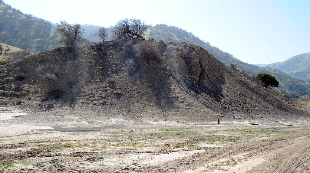 ". A mound of coal debris remains on the site of the abandoned mining town of Tesla in Livermore, Calif., on Friday, Feb. 15, 2013. The town and surrounding land is owned by the Carnegie State Vehicular Recreation Area. The coal mining town, named for Nikola Tesla, was closed in 1911 and became a ghost town. All the buildings are gone and now the California State Parks\' Off Highway Vehicle division has plans to use the 3,500 acre area to expand the Carnegie State Vehicular Recreation Area. However, a group called ""Save Tesla Park\"" opposes the expansion. The group wants the land designated as a low-impact recreation park, and historic and natural resource preserve. (Doug Duran/Staff)"