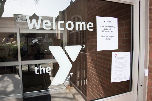 03/18/20 Wesley Bunnell | StaffrrThe New Britain YMCA was closed on Wednesday March 18, 2020 with a sign indicating no entry and for anyone with questions to call 860-229-3787.
