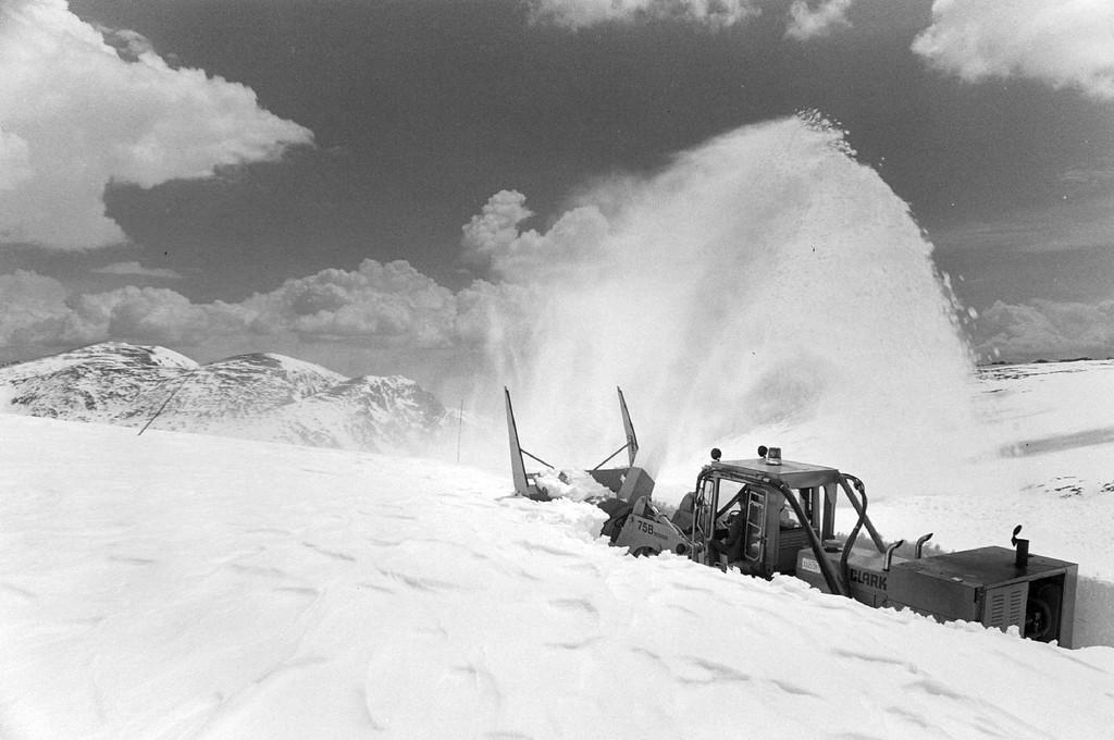 . A snow blaster works its way through a 10 foot snow drift, toward the summit of Trail Ridge Road in Rocky Mountain National Park, 1979. The U.S. Park service uses nine pieces of heavy equipment to clear the 26 mile roadway for the Memorial Day opening. It takes 30 days to clear the snow, which ranges in depth from 0 to 35 feet. (James A. Cook/The Denver post)