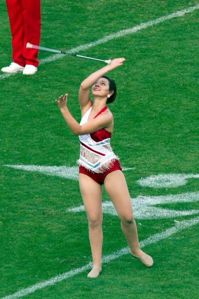 Twirler catching her baton