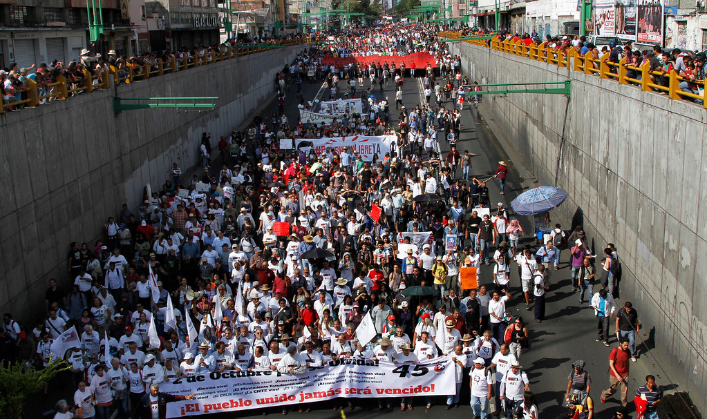 . People march to mark the anniversary of the Tlatelolco massacre in Mexico City, Wednesday, Oct. 2, 2013. Mexico commemorated the 45th anniversary of the massacre of students holding an anti-government protest, killed by men with guns and soldiers in 1968 days before the Summer Olympics celebrations in Mexico City. (AP Photo/Marco Ugarte)