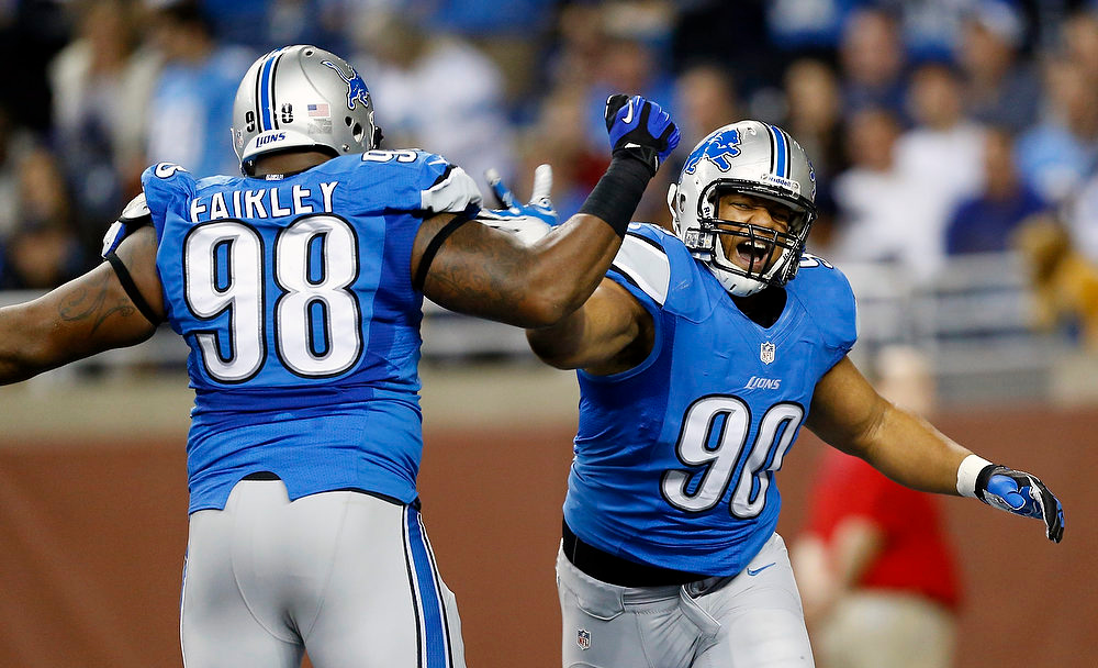 Description of . Detroit Lions defensive tackle Ndamukong Suh (90) celebrates a sack with teammate Nick Fairley (98) during the first quarter of an NFL football game against the Indianapolis Colts at Ford Field in Detroit, Sunday, Dec. 2, 2012. (AP Photo/Rick Osentoski)