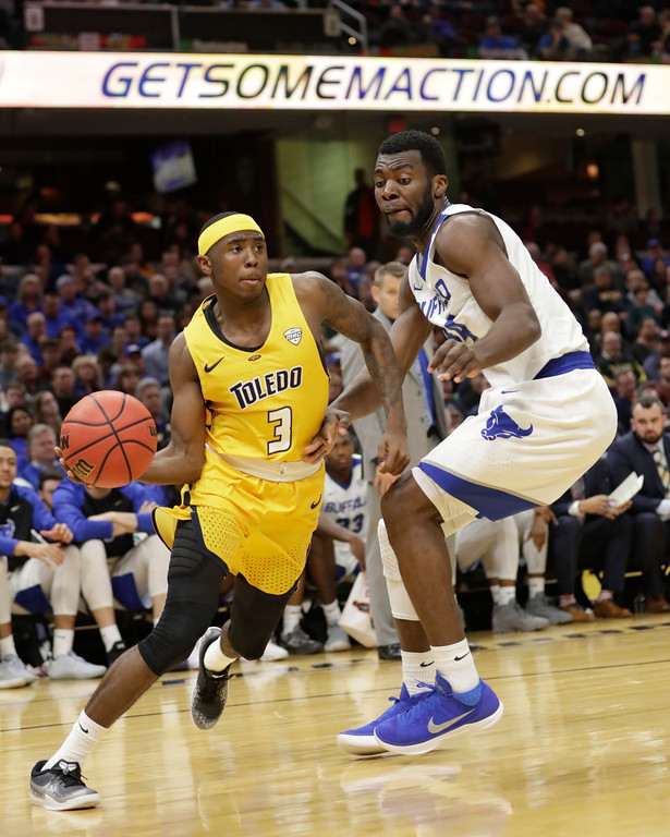 . Toledo\'s Marreon Jackson (3) drives past Buffalo\'s Ikenna Smart (34) during the first half of an NCAA college basketball championship game of the Mid-American Conference tournament, Saturday, March 10, 2018, in Cleveland. (AP Photo/Tony Dejak)