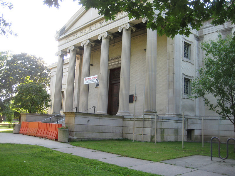 A grim period in September 2009 when the main Library entrance had to be barricaded for safety (from falling limestone).  The library remained open, via other doors.  This entrance re-opened as soon as a safety canopy was constructed.