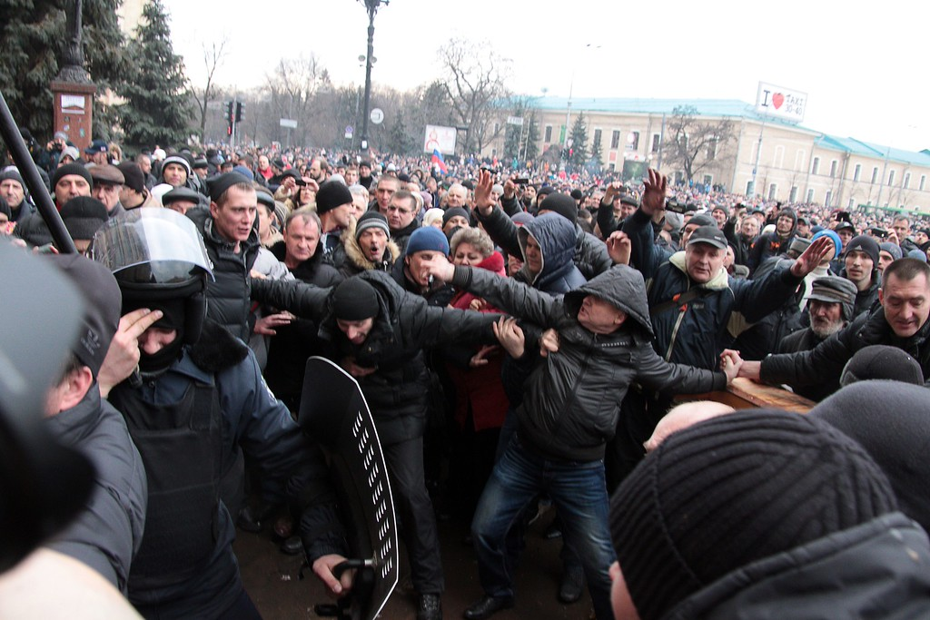 . Pro-Russian activists clash with Maidan supporters as they storm the regional government building in Kharkiv on March 1, 2014. Dozens were hurt on March 1, 2014 when a pro-Russia protest in Ukraine\'s eastern city of Kharkiv turned violent, with demonstrators trying to storm the local government building. Some 20,000 joined the protest against Kiev\'s new pro-West government after the ouster of Kremlin-backed leader Viktor Yanukovych, and later around 300 launched the assault on the government building. Stones and stun grenades were thrown though it was unclear by whom.  AFP PHOTO/ SERGEY BOBOK/AFP/Getty Images