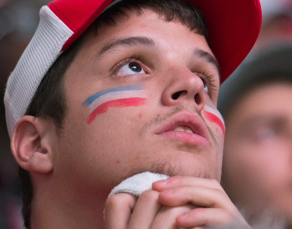 . A Montreal Canadiens fan watches the broadcast of Game 6 of the NHL hockey Stanley Cup Eastern Conference finals between the Canadiens and the New York Rangers, on the big screen at the Bell Centre in Montreal, Thursday, May 29, 2014. (AP Photo/The Canadian Press, Graham Hughes)