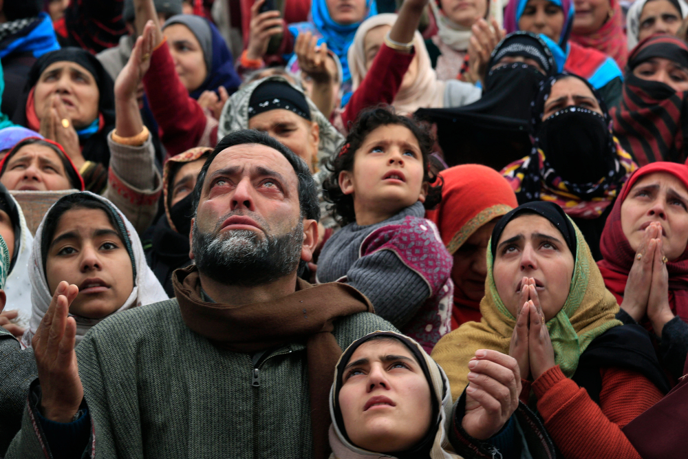 . Kashmiri Muslim devotees pray as a head priest displays a relic of Prophet Muhammad at the Hazratbal shrine on Eid-e-Milad, or birth anniversary of the Prophet, in Srinagar, India, Tuesday, Jan. 14, 2014. Thousands of Kashmiri Muslims gathered at the Hazratbal shrine, which houses a relic believed to be a hair from the beard of the prophet. (AP Photo/Dar Yasin)