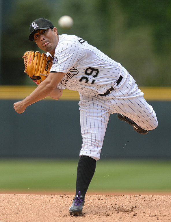 . DENVER, CO - JULY 5: Colorado starter Jorge De La Rosa served up a pitch in the first inning. The Colorado Rockies hosted the Los Angeles Dodgers at Coors Field Saturday afternoon, July 5, 2014.  Photo by Karl Gehring/The Denver Post