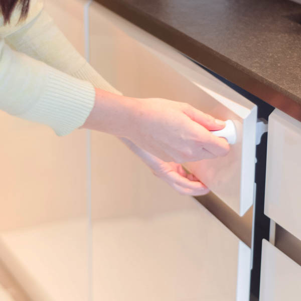 Fred_Home_Safety_Invisible_Magnet_Lock_Lifestyle_white_drawer.jpg