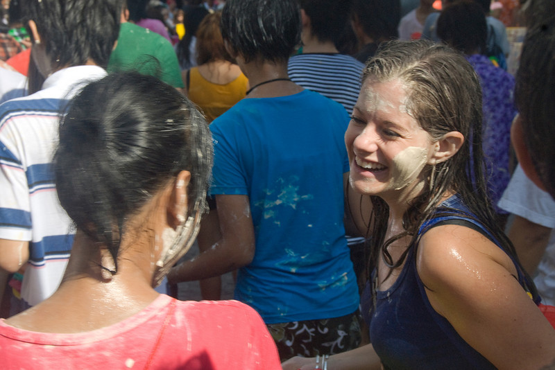 Tourist enjoying Songkran Festival with locals