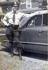 Harry Miller with car in uniform