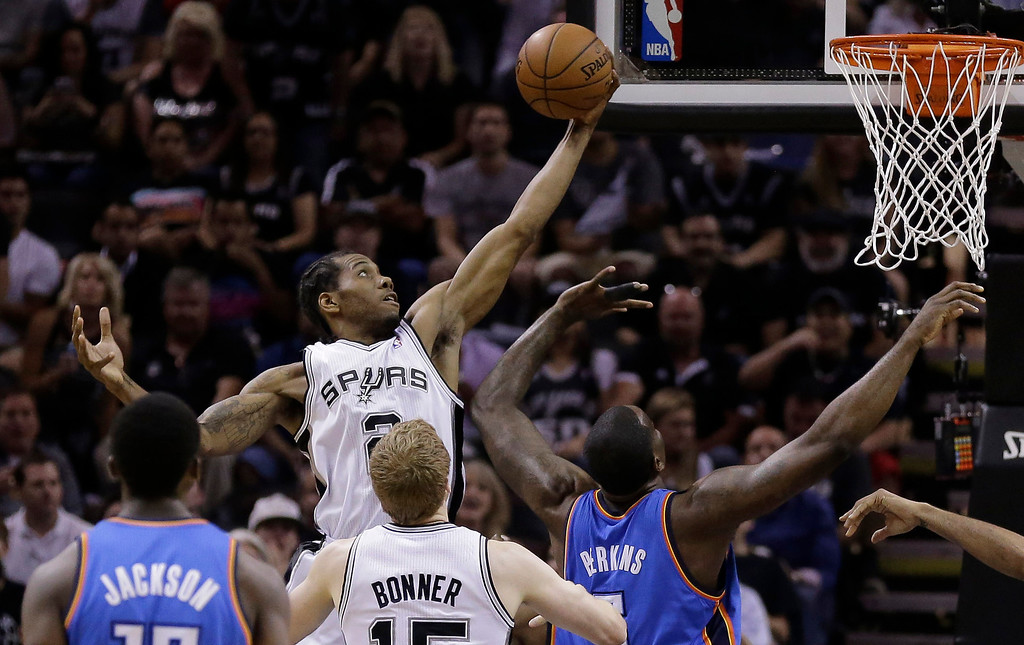. San Antonio Spurs\' Kawhi Leonard grabs a defensive rebound against the Oklahoma City Thunder during the first half of Game 5 of the Western Conference finals NBA basketball playoff series, Thursday, May 29, 2014, in San Antonio. (AP Photo/Eric Gay)