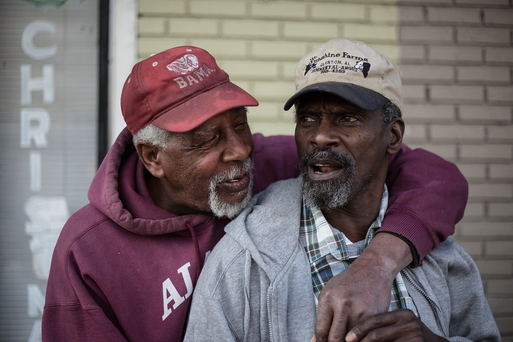 ". Clarence Nelson Jr., left, teases Johnny Manuel, 66, about his age while talking together along Alabama Avenue on Friday, March 6, 2015, in Selma, Ala. This weekend marks the 50th anniversary of ""Bloody Sunday,\' a civil rights march in which protestors were beaten, trampled and tear-gassed by police at the Edmund Pettus Bridge, in Selma. (AP Photo/The Casper Star-Tribune, Ryan Dorgan)"