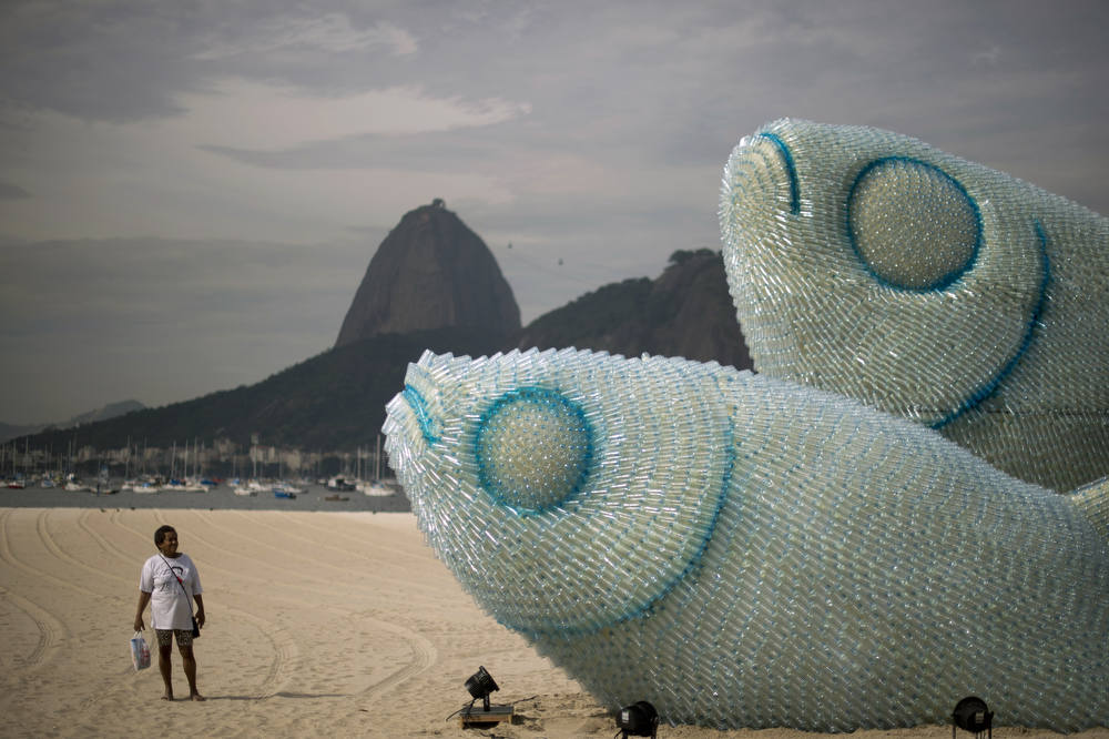 Description of . A woman looks at an installation made of recycled plastic bottles representing fishes, in Botafogo beach, in Rio de Janeiro, on June 19, 2012, in the sidelines of the UN Conference on Sustainable Development, Rio+20. The UN conference, which marks the 20th anniversary of the Earth Summit -- a landmark 1992 gathering that opened the debate on the future of the planet and its resources -- is the largest ever organized, with 50,000 delegates.  AFP PHOTO / Christophe  SIMON/AFP/Getty Images