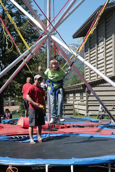 """Kyra wanted to try the """"bungie-trampoline"""" - which is just what it sounds like.  Attached to bungie cords over a trampoline.  As you can see, she enjoyed it.  This was also at Jackson Village"""