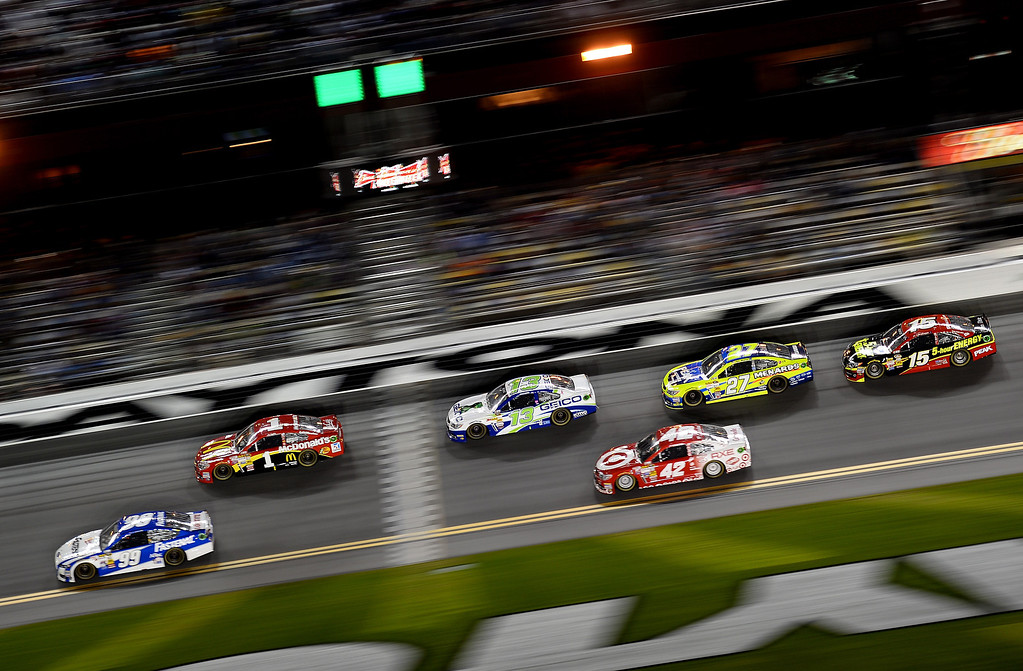 . Carl Edwards, driver of the #99 Fastenal Ford, and Jamie McMurray, driver of the #1 McDonald\'s Chevrolet, lead a pack of cars during the NASCAR Sprint Cup Series Budweiser Duel 2 at Daytona International Speedway on February 20, 2014 in Daytona Beach, Florida.  (Photo by Jared C. Tilton/Getty Images)