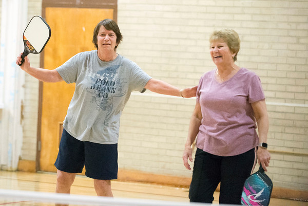 01/06/19 Wesley Bunnell | StaffrrJanet Thibodeau, L, laughs during a doubles game of pickle ball with her partner Sue Rushkowski on Monday afternoon at the Bristol Senior Center.