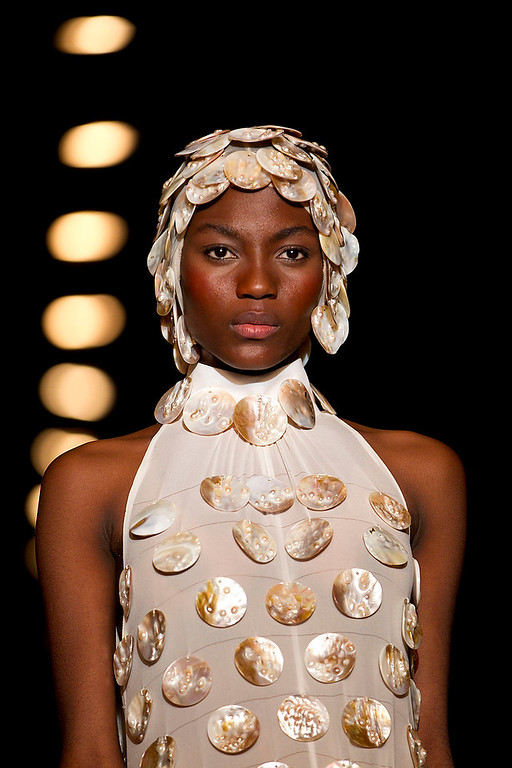 . A Model wears a creation by Gideon Oberson during a show at the Tel Aviv fashion week in Tel Aviv, Israel, Monday, Dec. 17, 2012. (AP Photo/Ariel Schalit)