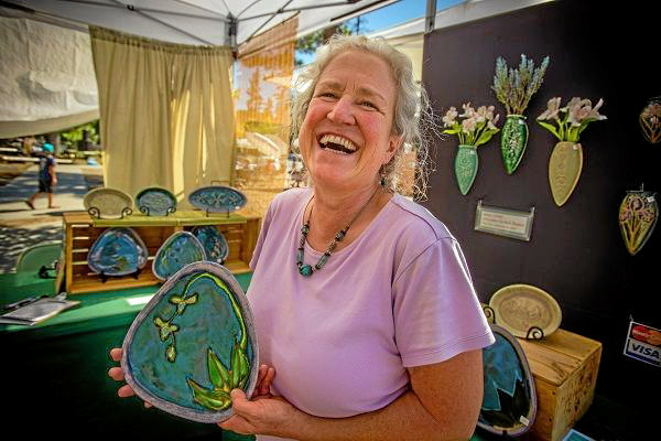 . Local Big Bear Lake artist, Annie Aldrich with her work during Art on the Lake XIV at the Bartlett Events Center in Big Bear Lake, Saturday , Aug. 17, 2013.  (Photo by Eric Reed for The Sun)
